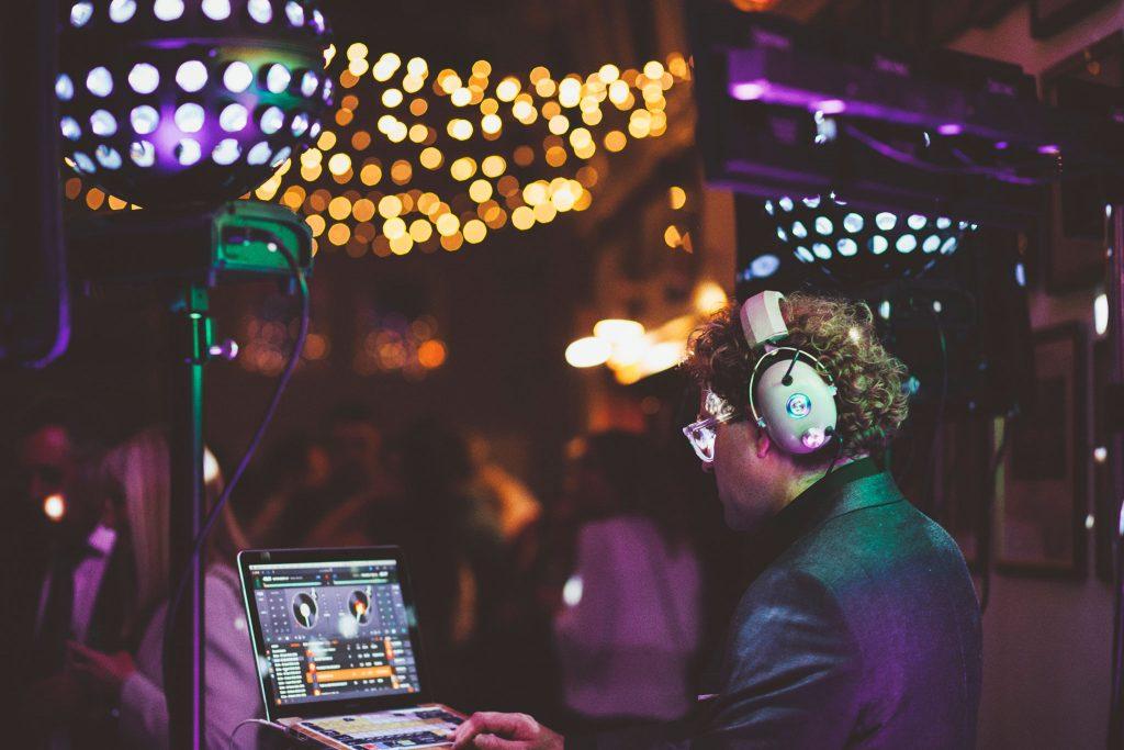 DJ selecting tunes on laptop